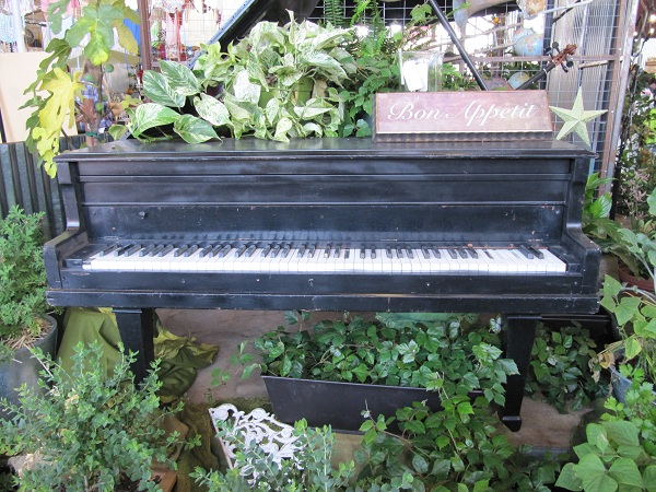 This plant display included a piano.